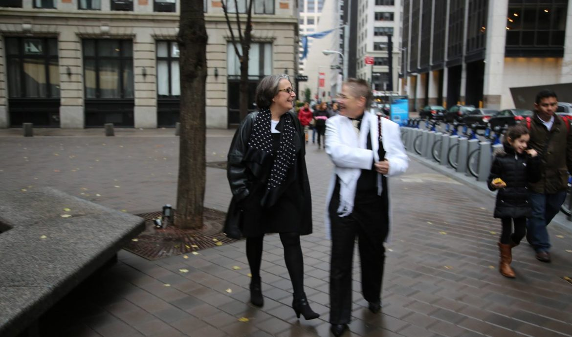 Amanda Hughes and Kirsten Wescott on their way to the chapel where they're getting married in New York City, November 17, 2013.